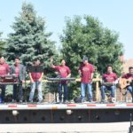 Grand Prairie Foods employees playing instruments outside during their company summer party