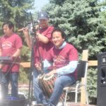 Grand Prairie Foods employees playing instruments at their summer party